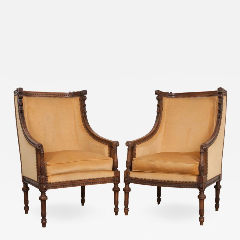 PAIR OF FRENCH 19TH CENTURY LOUIS XVI CARVED WALNUT BERG RES
