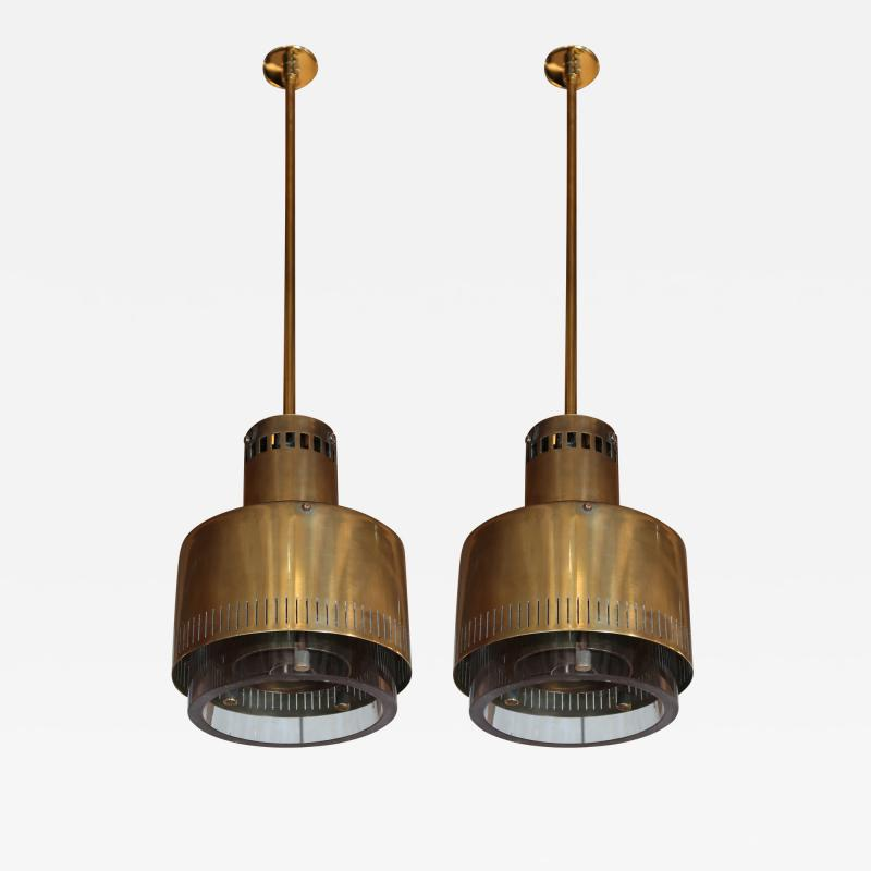 Paavo Tynell A pair of brass and glass chandeliers by Paavo Tynell Italy 50