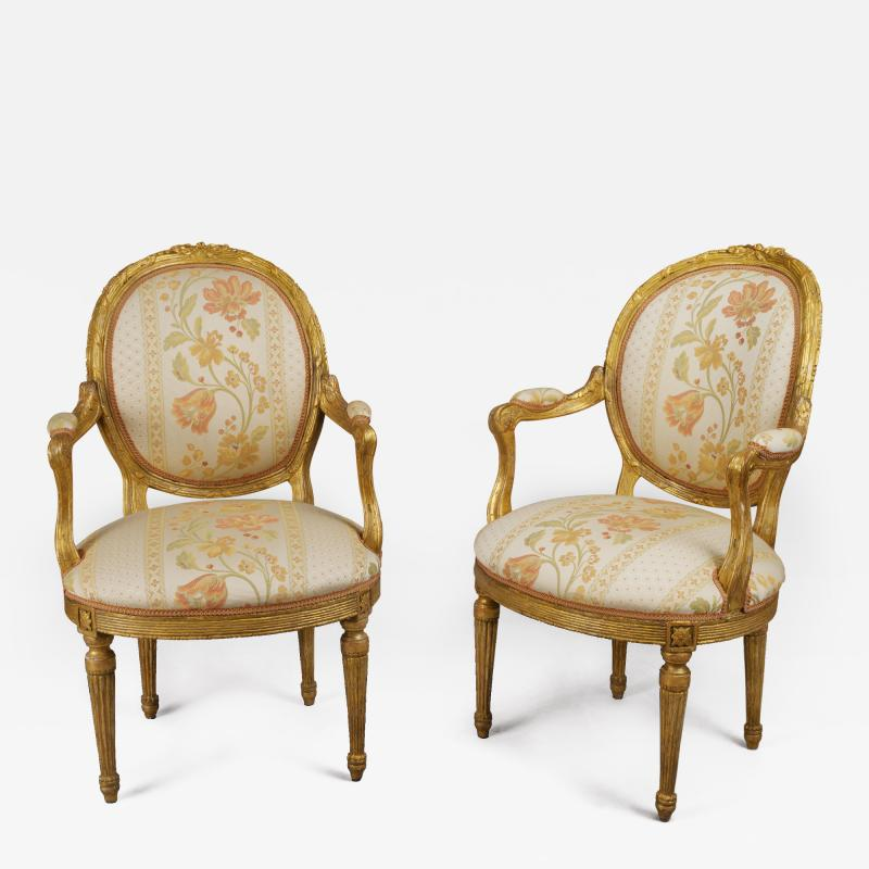 Pair of 18th Century Carved Gilt Armchairs