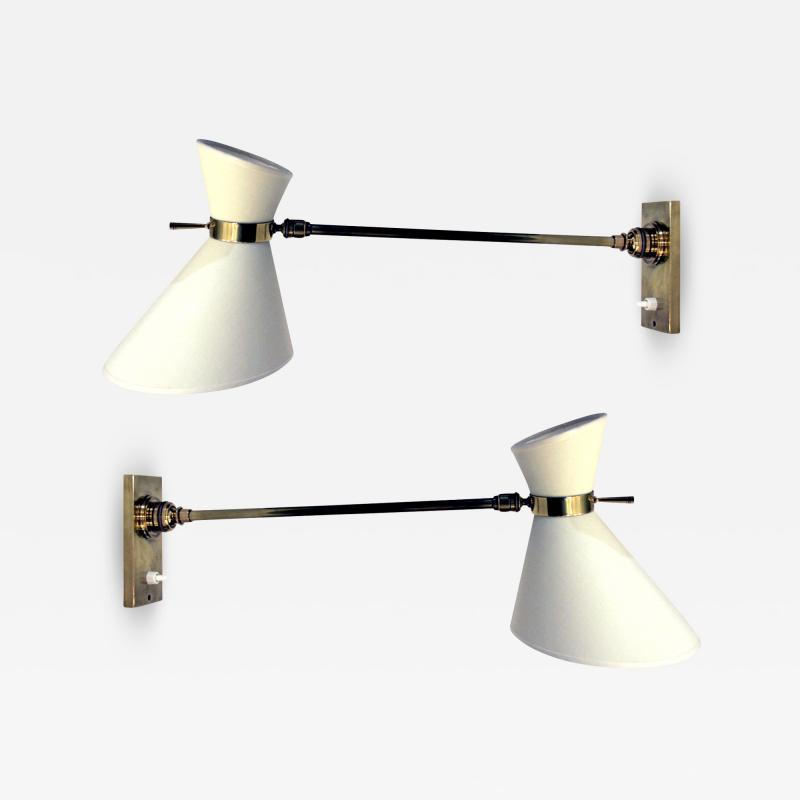 Pair of 1950s wall lights in brass with diabolo shades