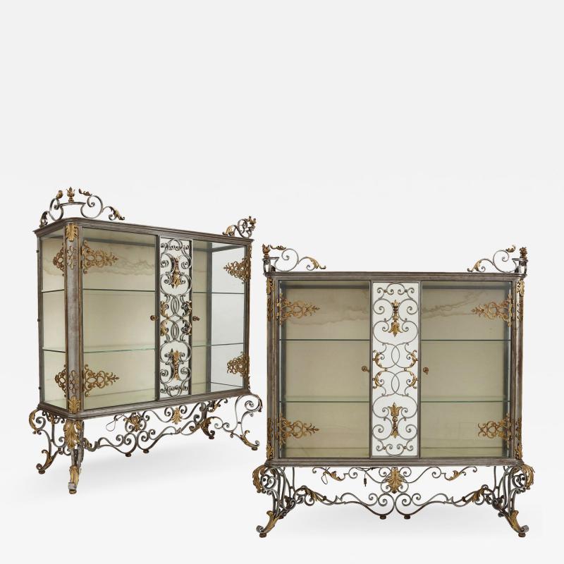 Pair of Art Nouveau gilt metal and steel vitrines