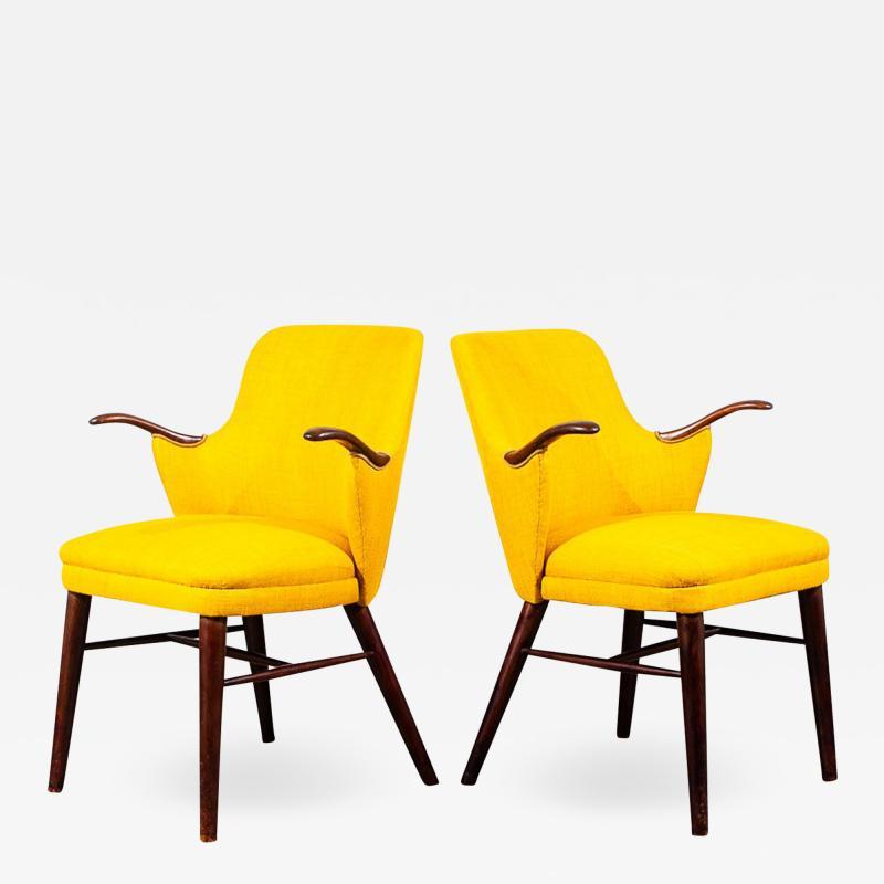 Pair of Danish Rosewood Mid Century Arm Chairs