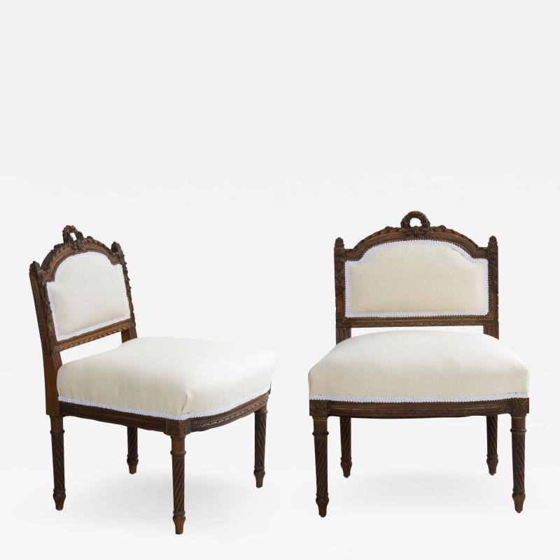 Pair of French Louis XVI Style Carved Walnut Antique Accent Side Chairs