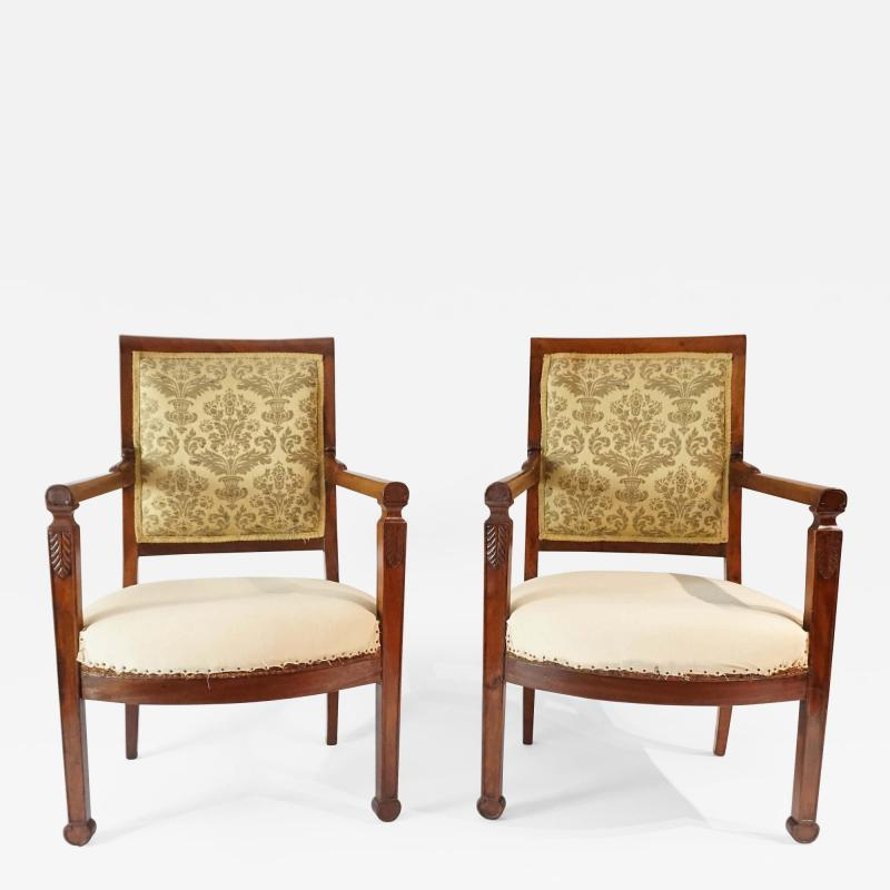 Pair of French Restauration Period Mahogany Fauteuils