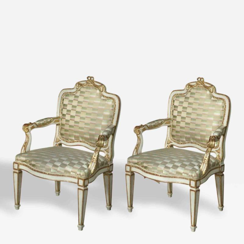Pair of Swedish Neoclassic Cream Painted Parcel Gilt Arm Chairs