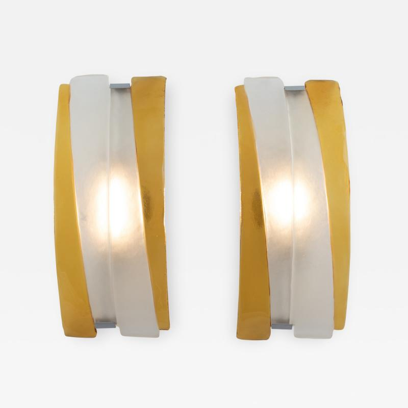 Pair of arched Murano sconces in frosted and amber glass circa 1980s