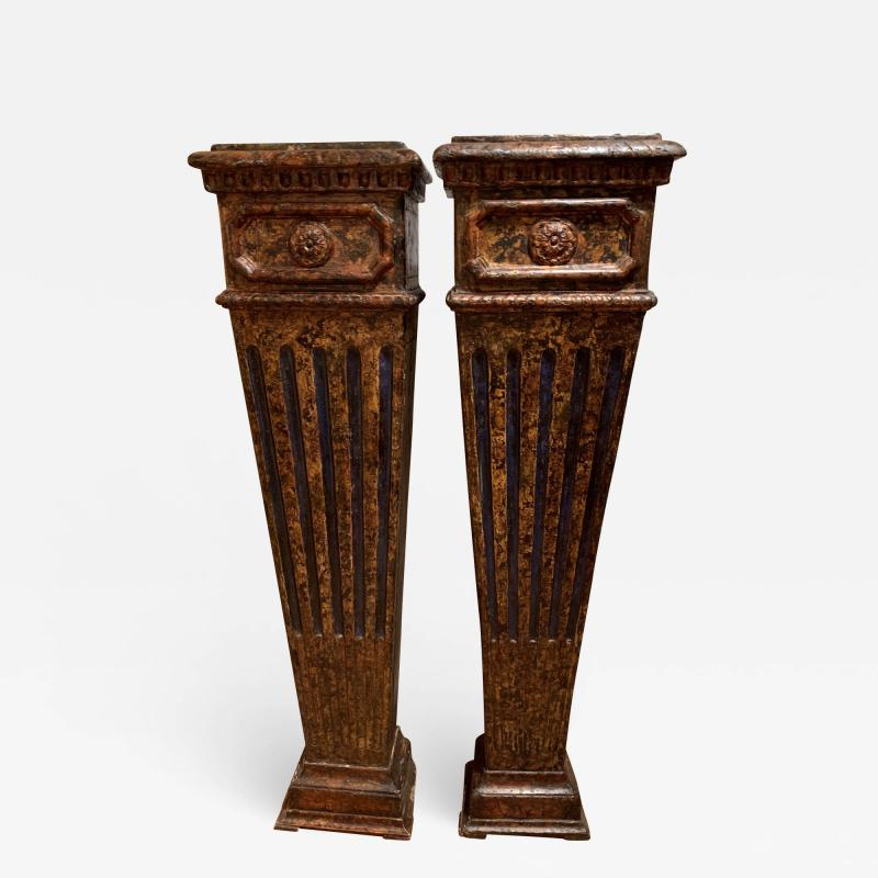 Pair of carved wood faux marbleized pedestals