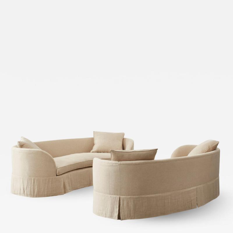 Pair of curved banana skirted sofas USA 1970s