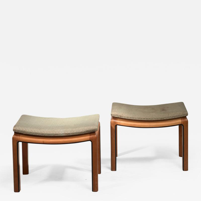 Pair of curved elm and fabric stools or ottomans