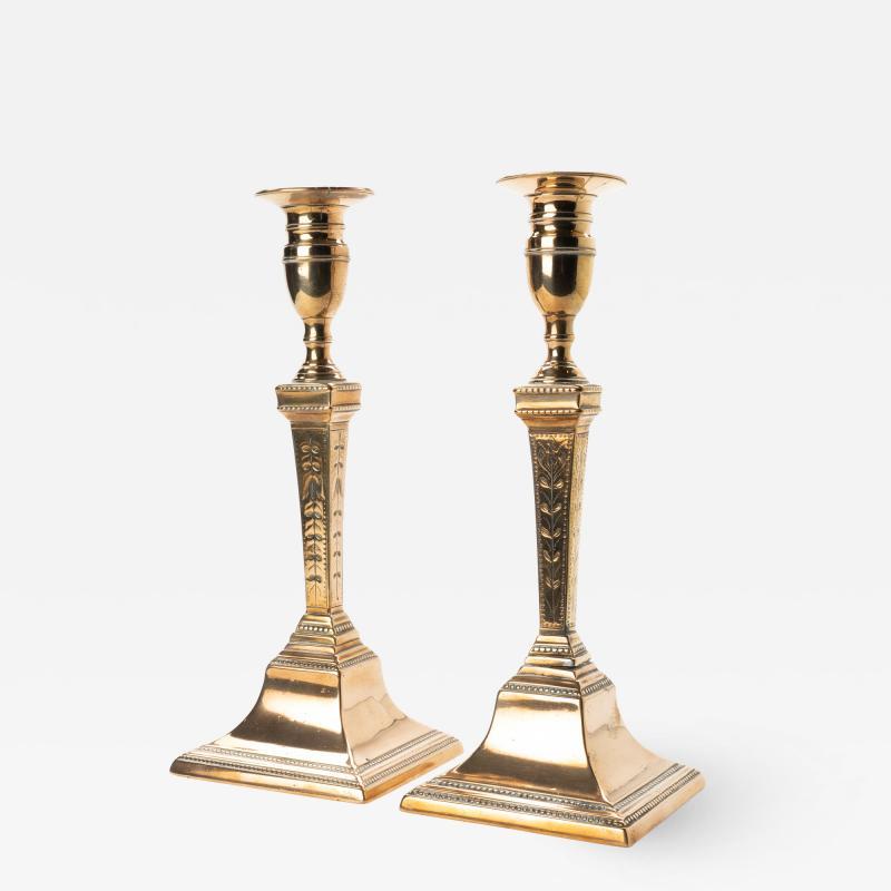 Pair of engraved bell metal candlesticks