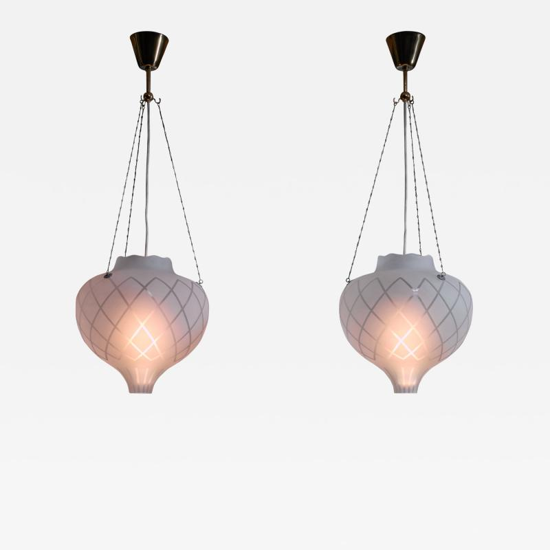 Pair of frosted glass pendants