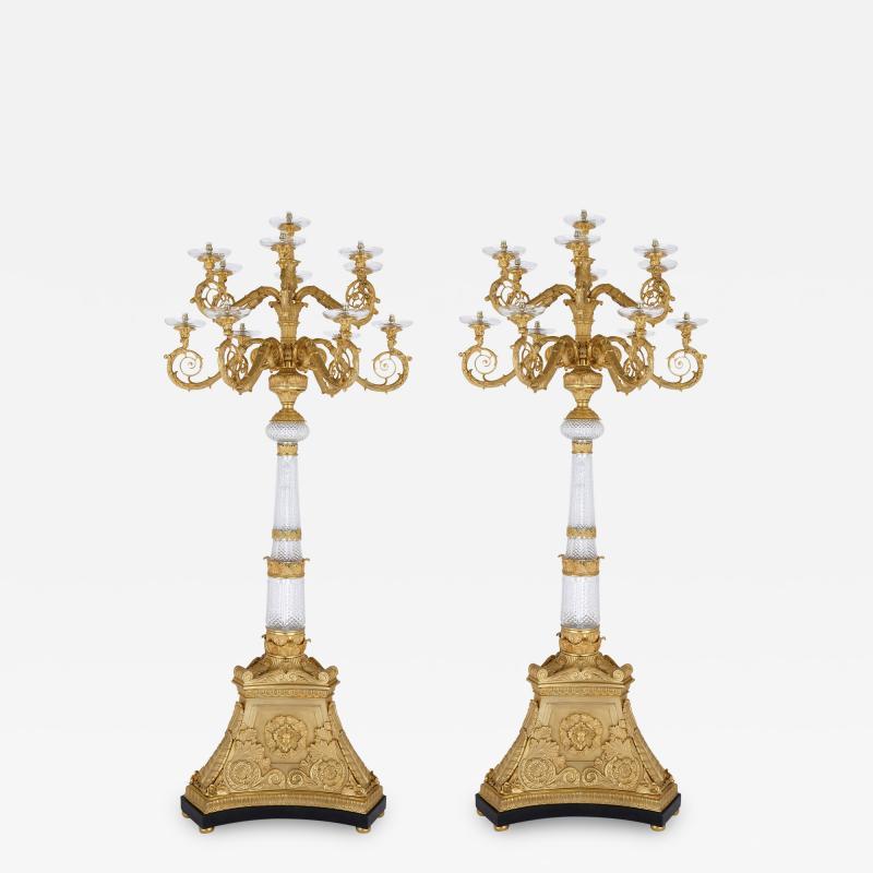 Pair of monumental gilt bronze and glass floor standing candelabra