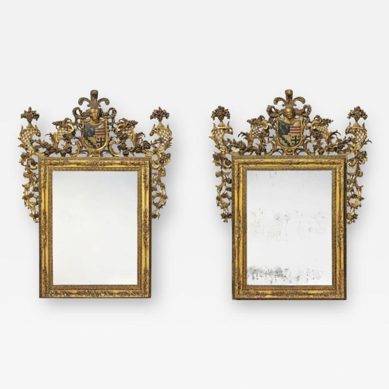 Pair of polychrome decorated giltwood antique mirrors