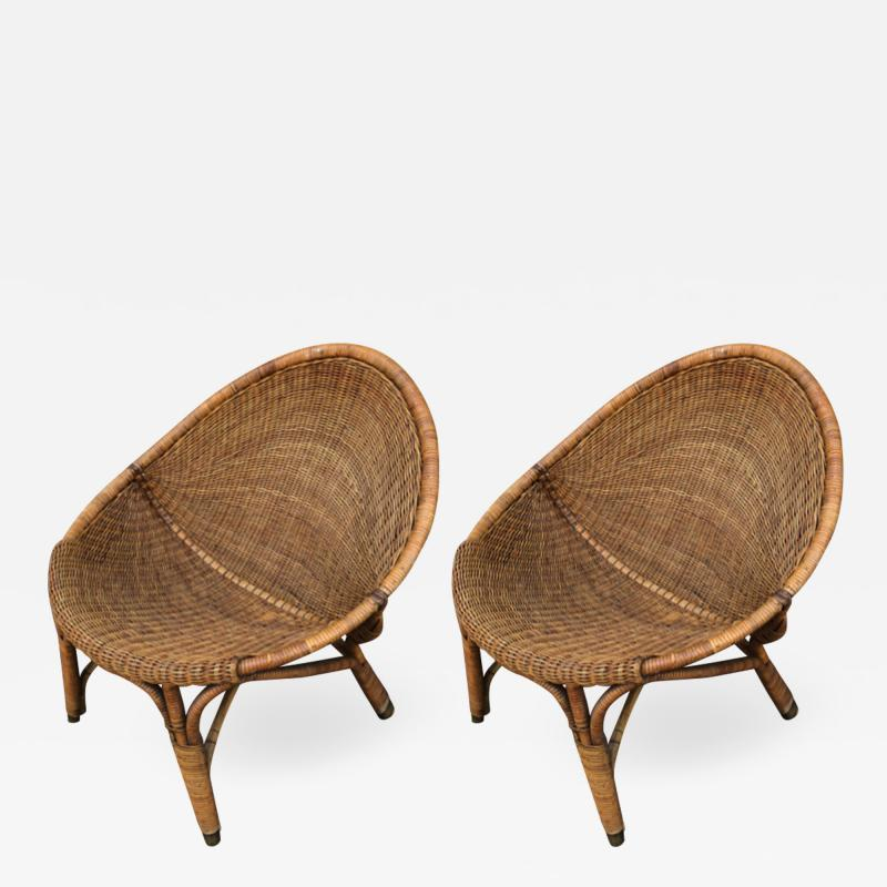 Pair of rattan oeuf shaped lounge chairs with brass leg end