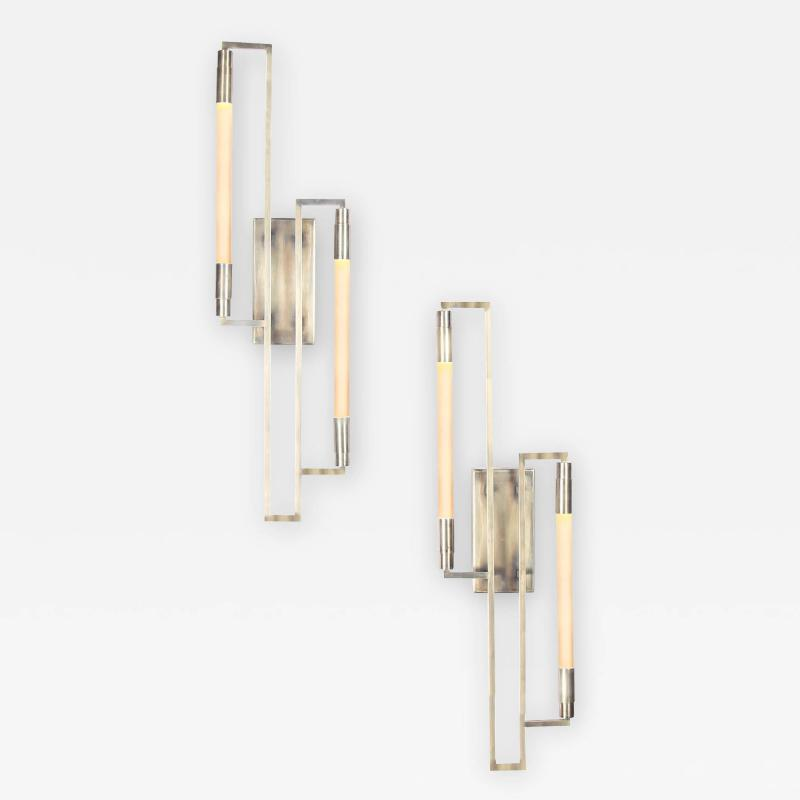 Pair of sconces in the style of Jacques ADNET