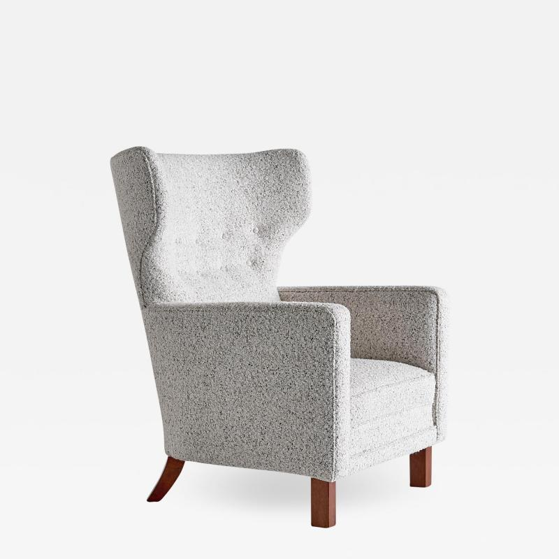 Paul Boman Paul Boman Wingback Chair in Pearl Boucl Fabric and Beech Finland 1940s