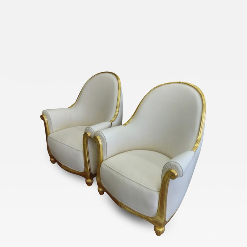 Paul Follot Paul Follot pair of gold leaf carved art deco comfy corbeille chairs