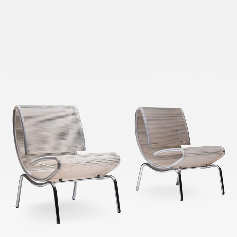 Post modern pair of easy chairs in chrome and plastic wire 1960s