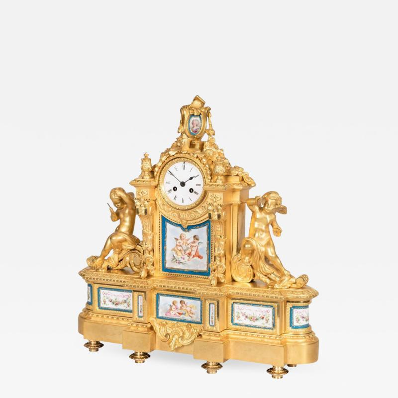 Raingo Fr res 19th Century French Gilt Bronze and Porcelain Clock in the Louis XVI Taste