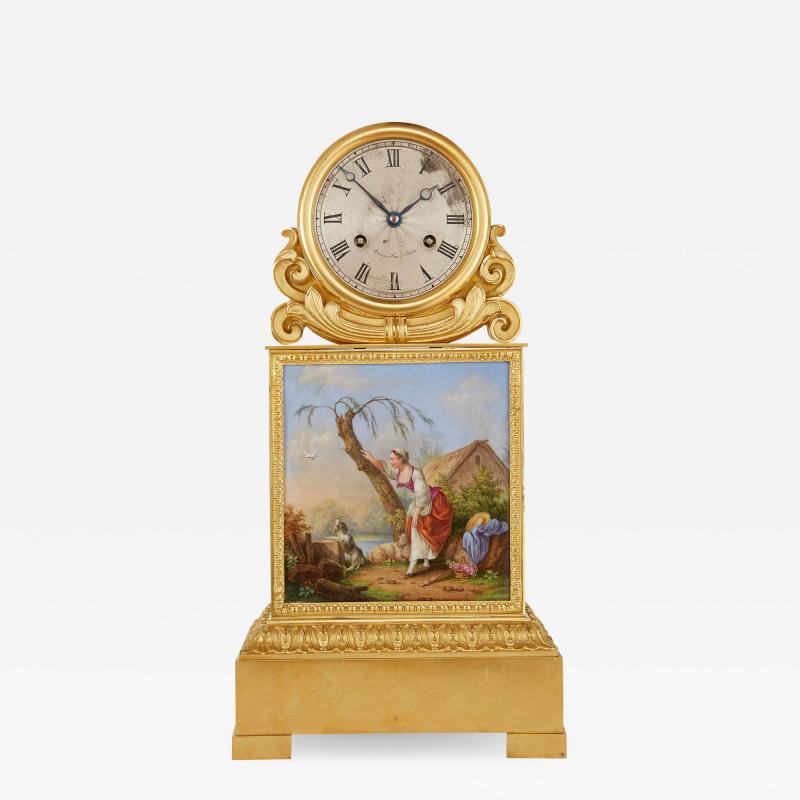 Raingo Fr res Ormolu and porcelain antique mantel clock by Raingo Fr res