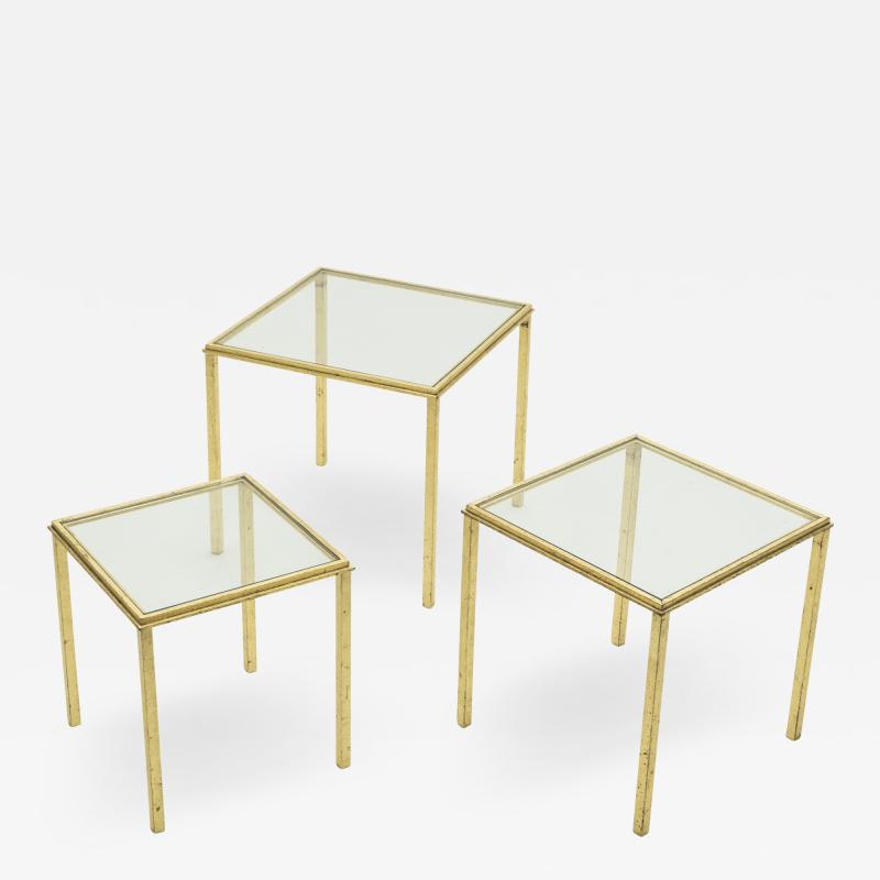 Roger Thibier Mid century Roger Thibier gilt wrought iron gold leaf nesting tables 1960s