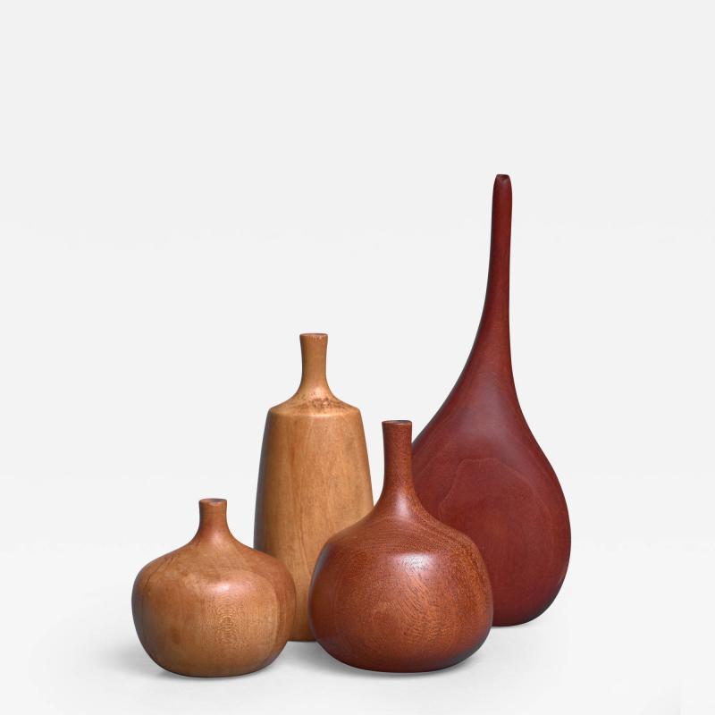 Rude Osolnik Set of four turned wood vases three by Rude Osolnik USA 1960s