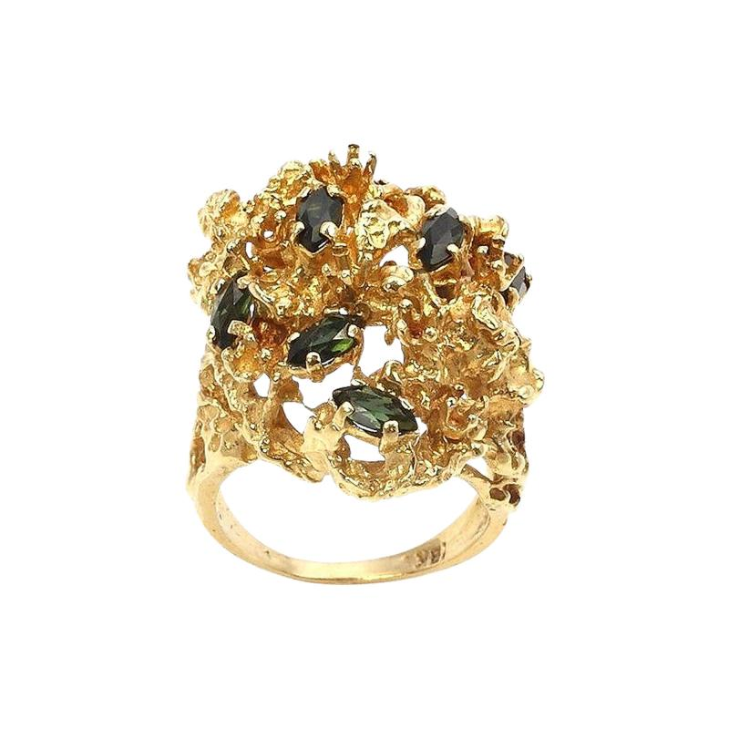 SCATTERED MARQUISE CUT GREEN TOURMALINE AND 18K YELLOW GOLD CLUSTER RING