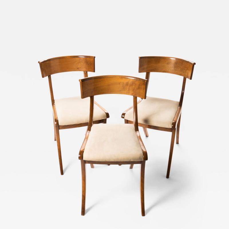 Set of three sabre leg Klismos form side chairs