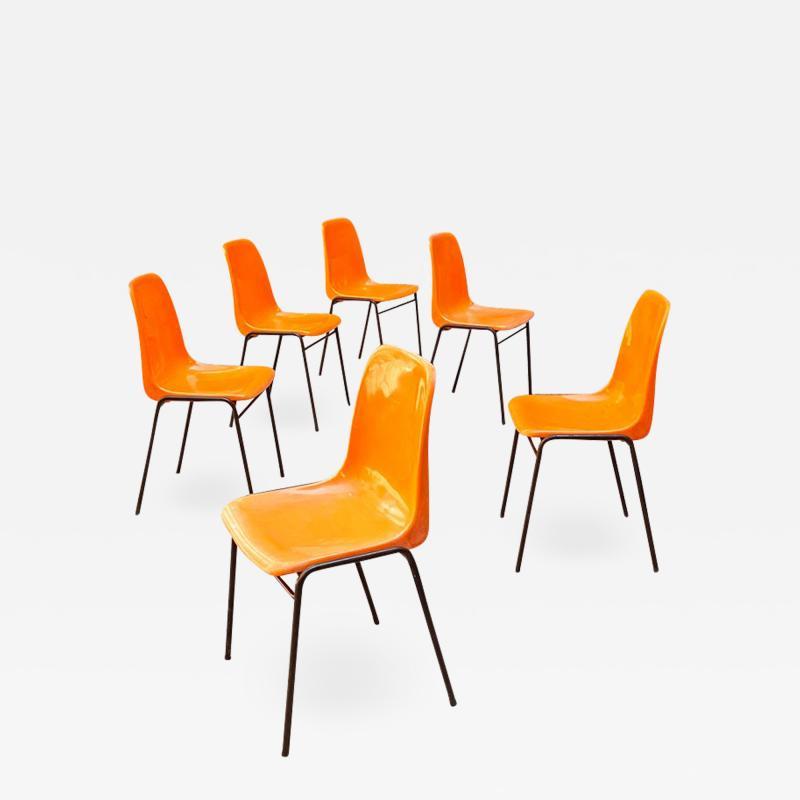 Stackable orange plastic chairs 1960s