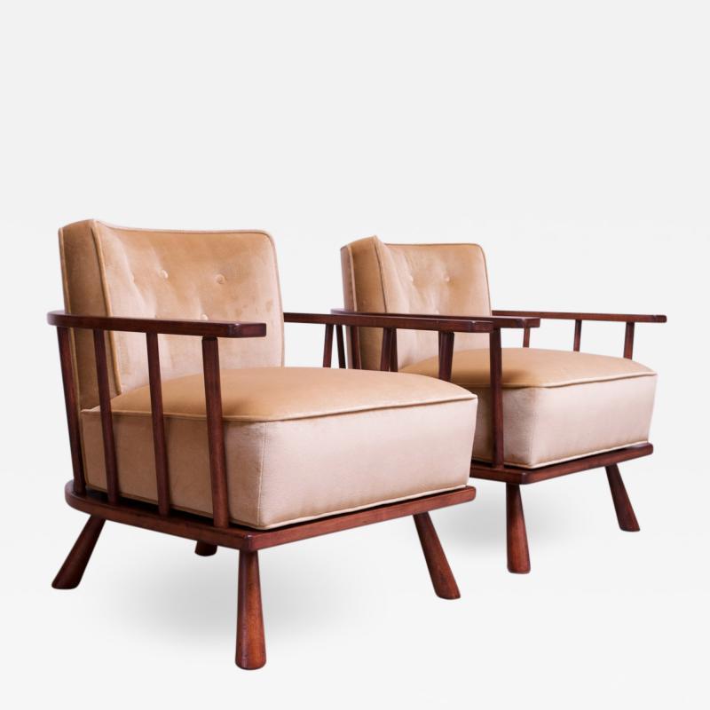 T H Robsjohn Gibbings Pair of T H Robsjohn Gibbings Stained Walnut Barrel Back Lounge Chairs