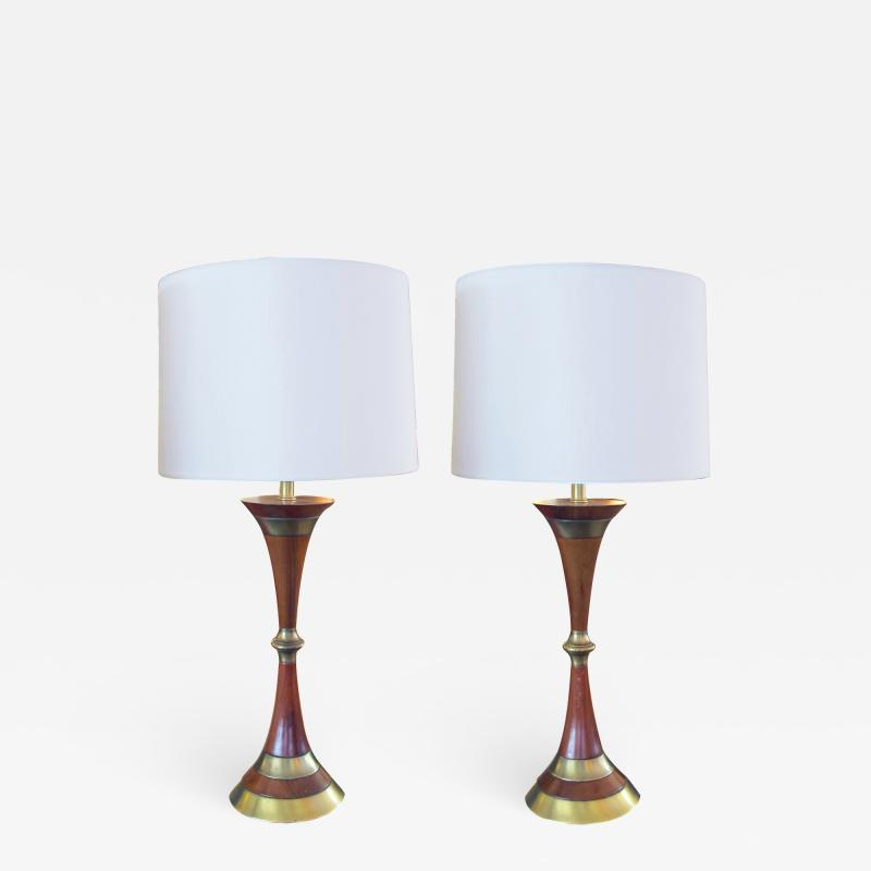 Tony Paul A Shapely Pair of American Mid century Walnut and Brass Hour glass shaped Lamps