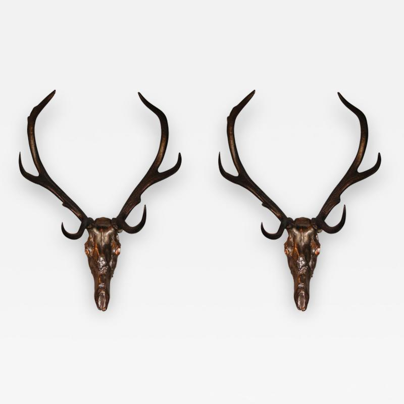 Two 1970s sconces shaped like a deers skull with antlers