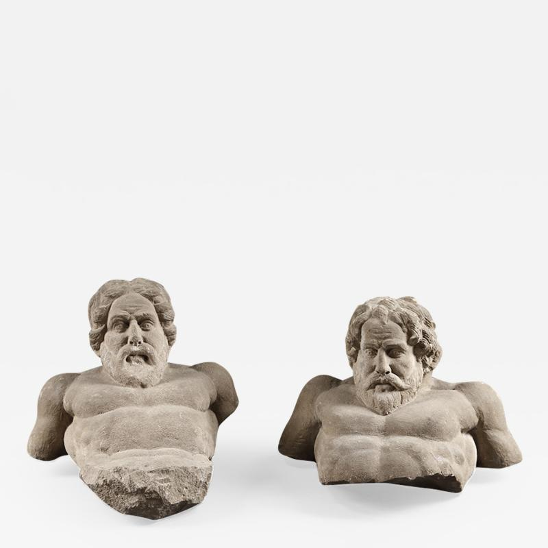 Two Atlantean stone supports carved in the shape of fierce men