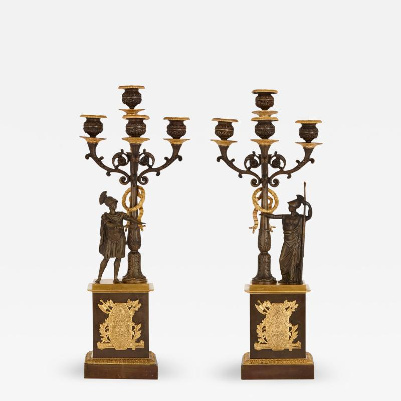 Two Empire style gilt and patinated bronze candelabra