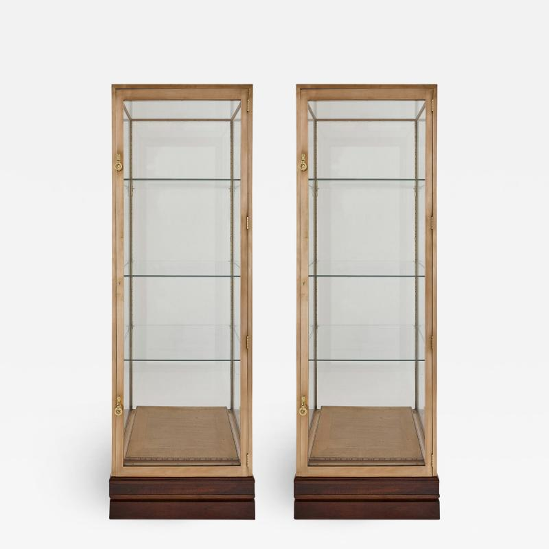 Two French burnished brass Art Deco vitrines