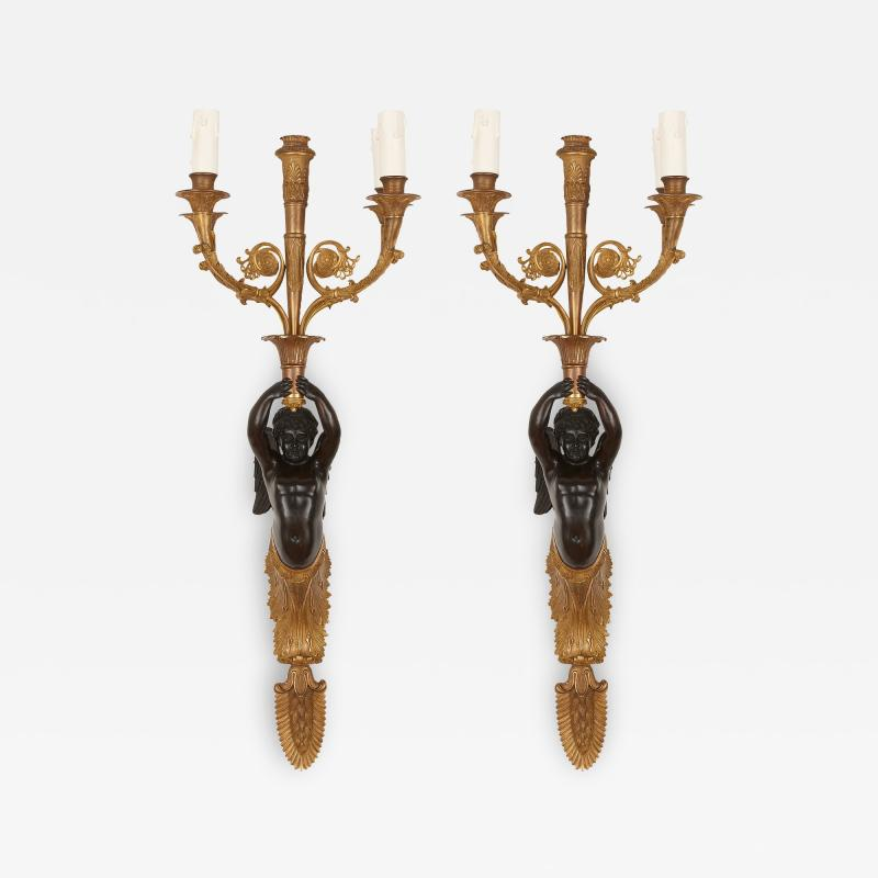 Two French gilt and patinated bronze sconces