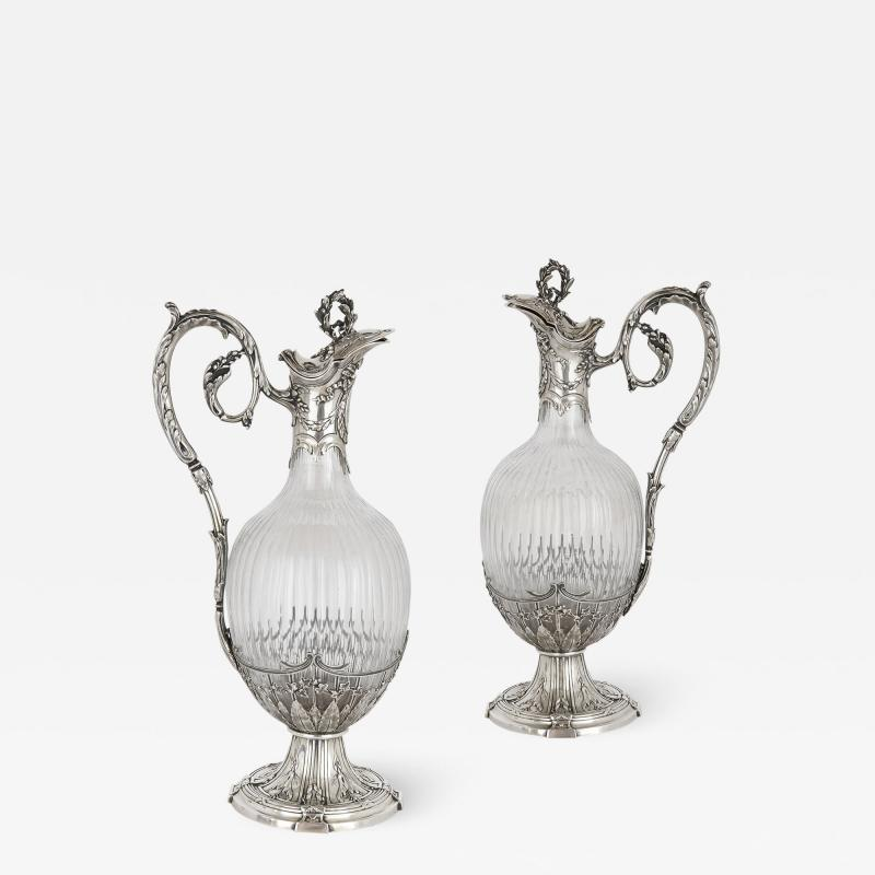 Victor Boivin Pair of Rococo style silver mounted crystal jugs by Boivin
