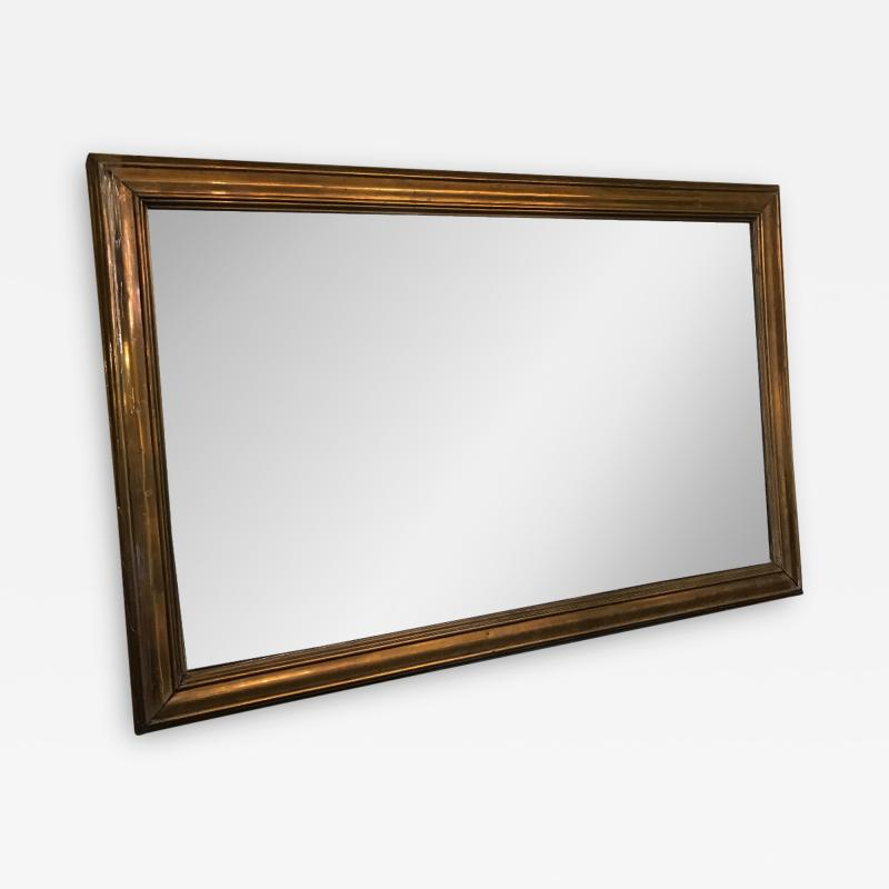 WOOD MIRROR COVERED IN BRASS