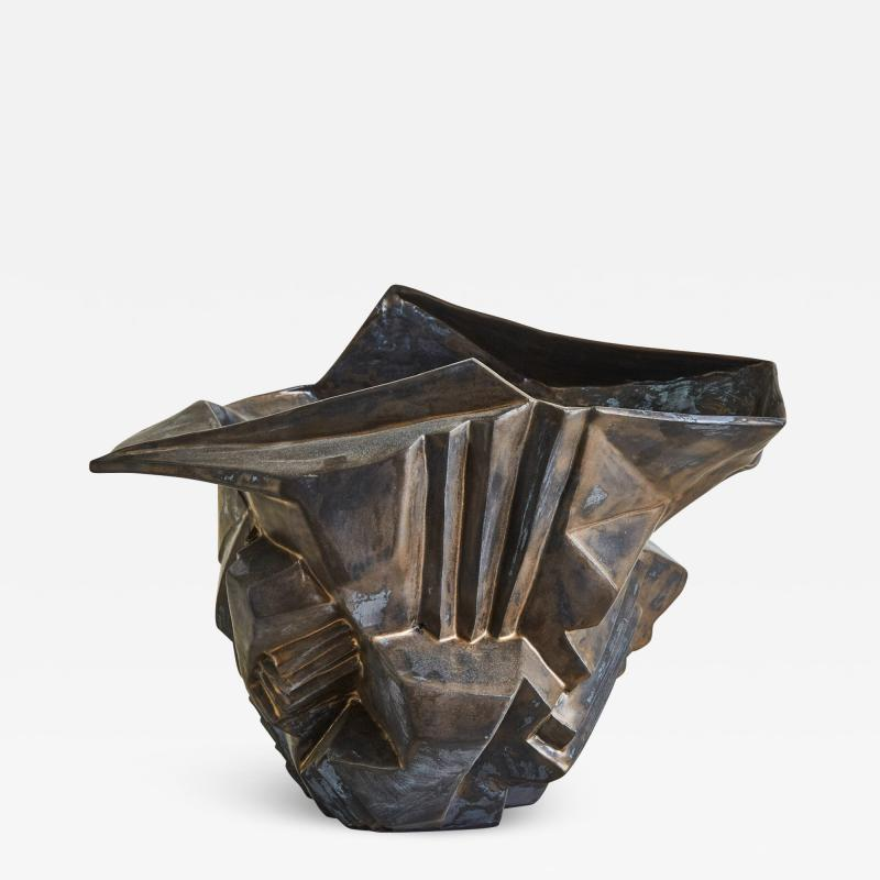 Wheel thrown and manipulated cubist vessel in white stoneware