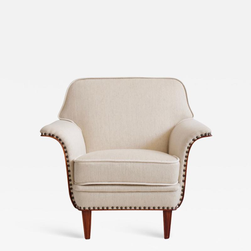 White Armchair with Stained Beech Legs and Stud Decorations