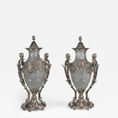 Baccarat A Pair of Silvered Bronze Urns and Covers