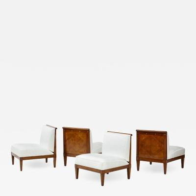 Baker Furniture Company Set of four mid century modern walnut lounge chairs by Baker Furniture