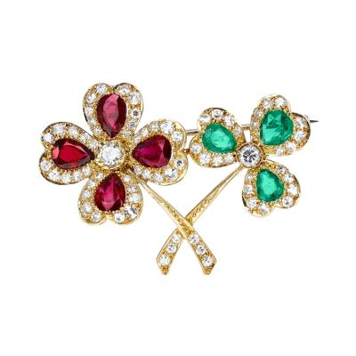Cartier CARTIER THREE LEAF AND FOUR LEAF CLOVER PEAR EMERALD RUBY BROOCH WITH DIAMONDS