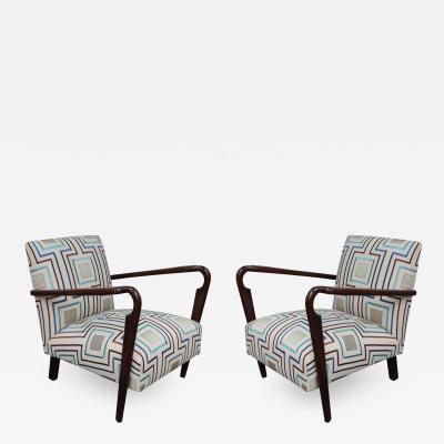 Cassina A pair of armchairs by Cassina G Bosoni Milano 2008 p 134 Italy 40