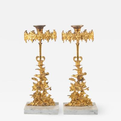 Cornelius and Company Pair of cast brass gilt lacquer girandole candlesticks on a marble base