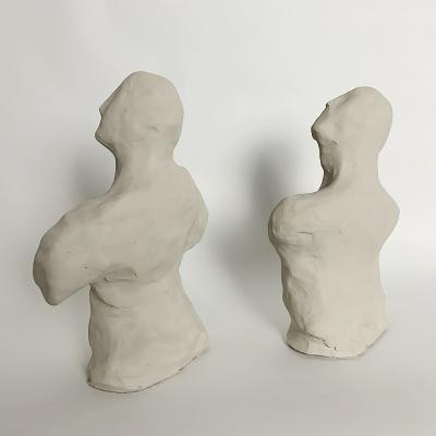 Dainche AWAY Pair of clay sculptures
