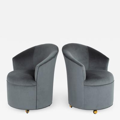 Directional PAIR OF SCULPTURAL DIRECTIONAL BARREL CHAIRS ON CASTERS CIRCA 1980S