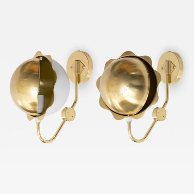 E H AB SCANDINAVIAN MODERN ECLIPSE SCONCES IN BRASS FROM EH AB SWEDEN