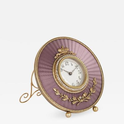 Faberg Gold and pearl circular table clock in the manner of Faberg