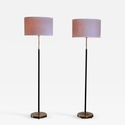Falkenbergs Belysning Pair of Falkenberg floor lamps in brass and leather